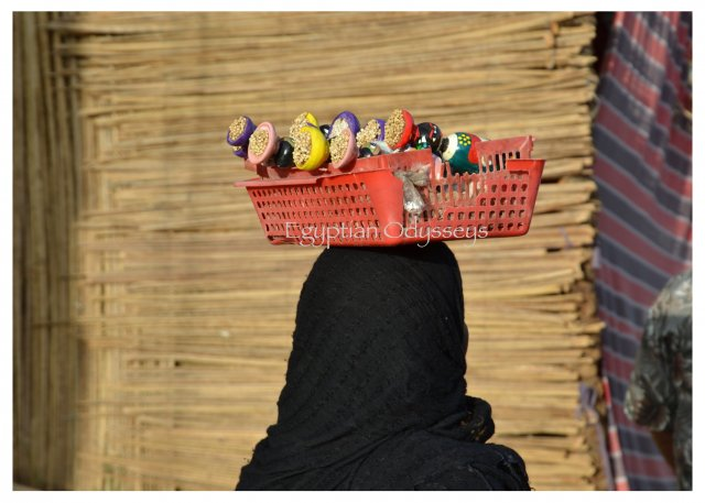 Aswan: a Nubian villager selling wooden dolls